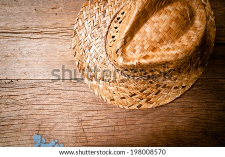 Handmade Straw Hat on Wood Background, Vintage Rustic Style. - stock photo