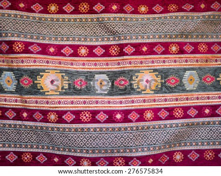 Handmade tapestry in vintage style - carpet of ethnic interior in Turkey. Traditional Turkish rug - oriental craft, decor of home interior. - stock photo