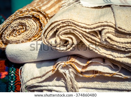 Handmade textile - natural fabric of flax and cotton tapestry in vintage style. Canvas and burlap closeup - homespun fabric of handwork. Ethnic textile for decoration of home interior. - stock photo