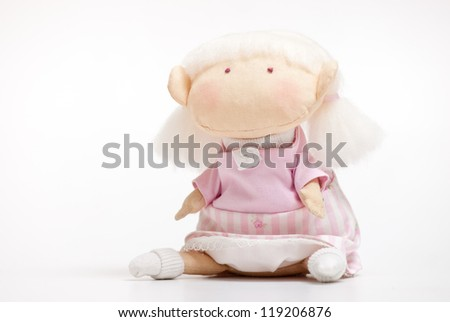 handmade toy cute litlle girl on the white