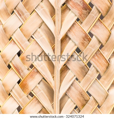Handmade weave tracery from leaves coconut dry. - stock photo