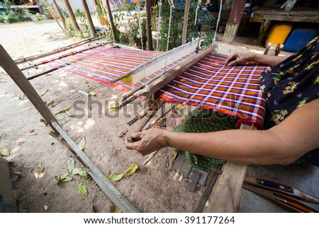 Handmade weave, traditional fabric made process in Thailand.