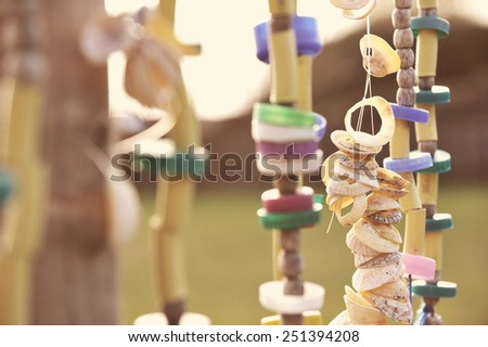 Handmade wind chimes with vintage effect. - stock photo
