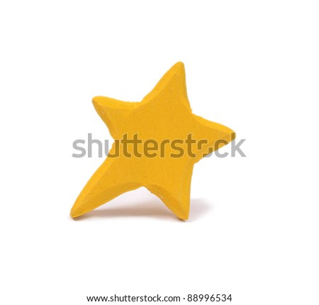 Handmade wooden star isolated on a white background