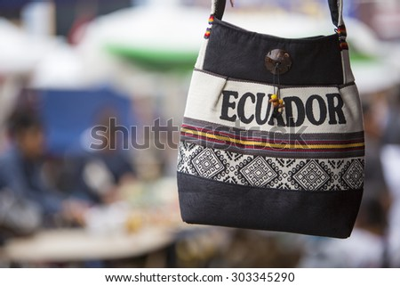 Handmade wool bag for sale at the outdoor craft market in Otavalo. Ecuador is written on the bag. - stock photo