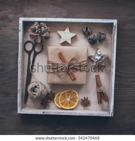Handmade wrapped christmas present with tools and decorations - stock photo