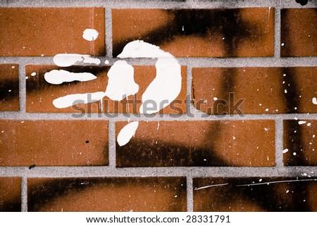 handprint on brick - stock photo