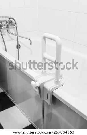 handrail for disabled and elderly people in the bathroom. Focus on the handrail - stock photo