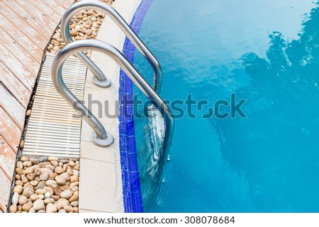 Handrail of the public swimming pool background - stock photo