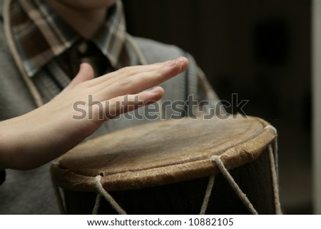 hands above the drum before hit - stock photo