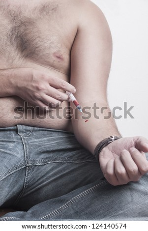 Hands addict with syringe to inject a drug