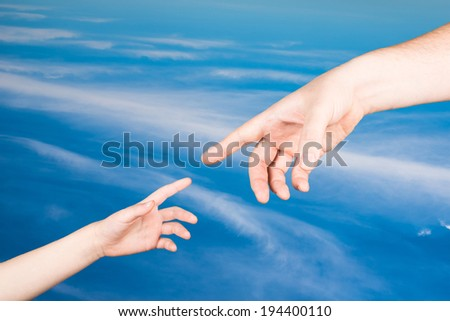 hands against the sky