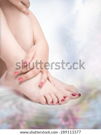 hands and bare feet with nail polish