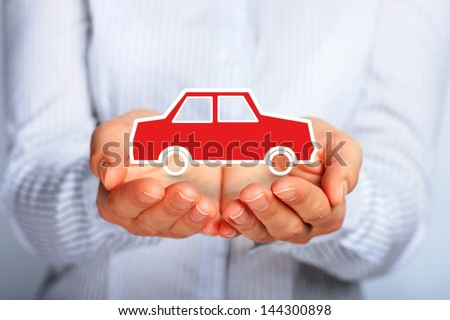 Hands and car. Car insurance concept. - stock photo