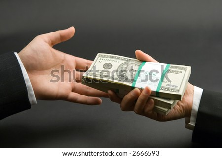 hands and dollars isolated on black background