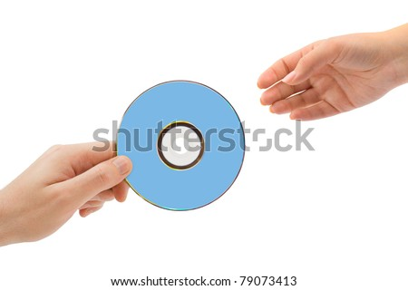Hands and dvd isolated on white background - stock photo