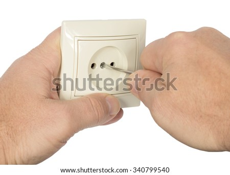 Hands and electrical outlet. Isolation on a white background. Clipping path.