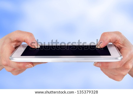 Hands and fingers on the tablet PC