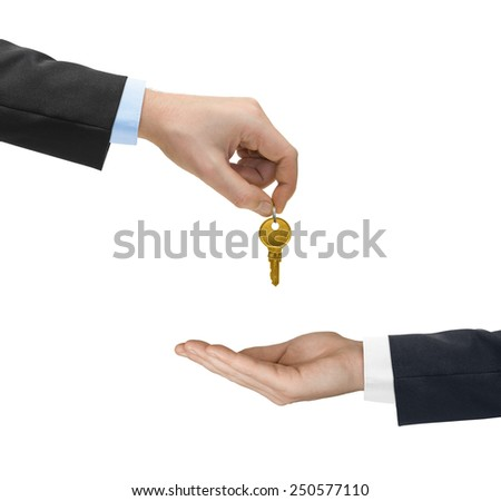 Hands and golden key isolated on white background - stock photo
