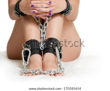 Hands and Legs in shackles - stock photo