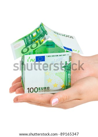 Hands and money house isolated on white background