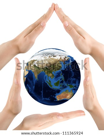 Hands and planet on white background. Elements of this image furnished by NASA.