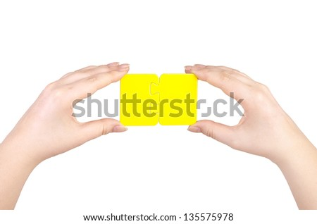 Hands and puzzle, isolated on white background. - stock photo
