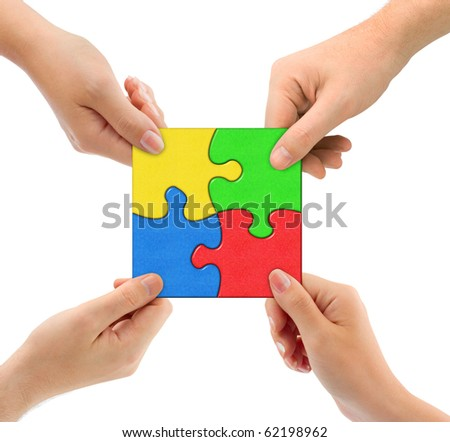 Hands and puzzle Team isolated on white background