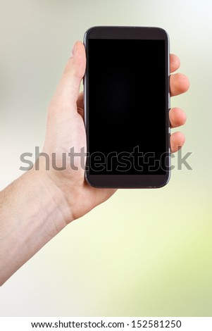 Hands and Smartphone - stock photo