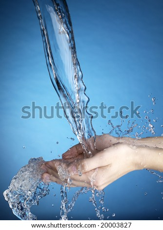 Hands and stream of water. Very high resolution.