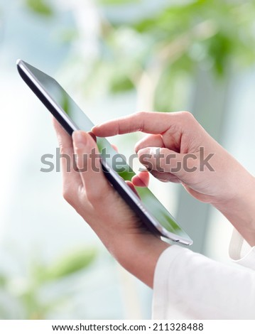 Hands and tablet PC - stock photo