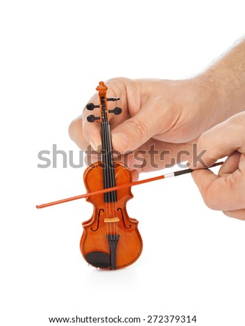 Hands and toy violin isolated on white background - stock photo