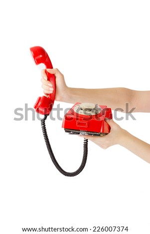 Hands are holding red telephone handset with open connection - stock photo