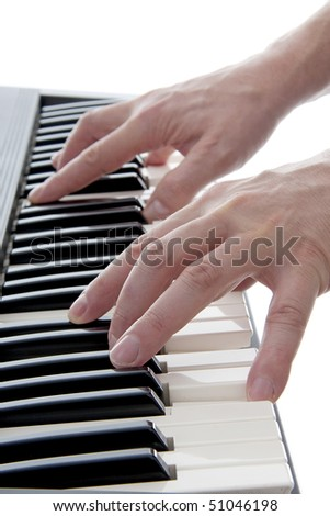 Hands are playing the piano over white background