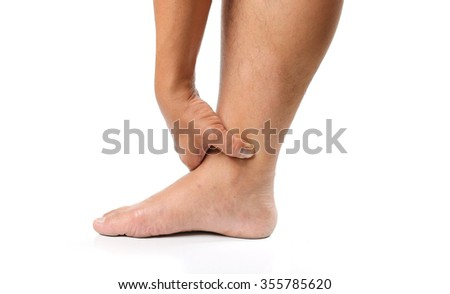 Hands are squeezed ankle atmosphere to spread the pain from his injuries on white background.