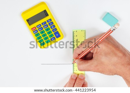 Hands at work with a pencil and ruler on a white sheet of paper - stock photo