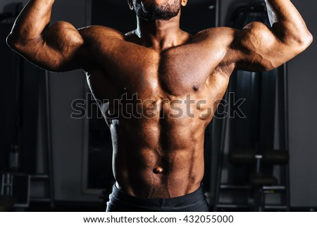 Hands athlete. Exercise for biceps - stock photo