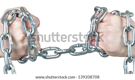 Hands attempt to pull a thick steel chain apart. - stock photo