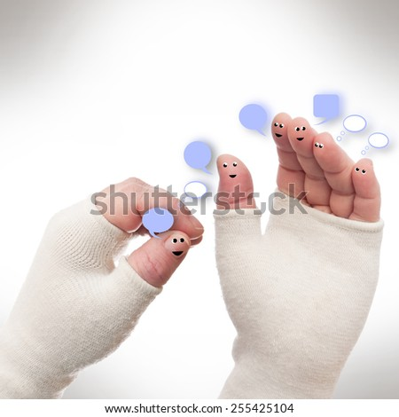 Hands bandaged with smileys and lettering boxes - stock photo