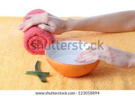 Hands before manicure in beautician salon, isolated - stock photo