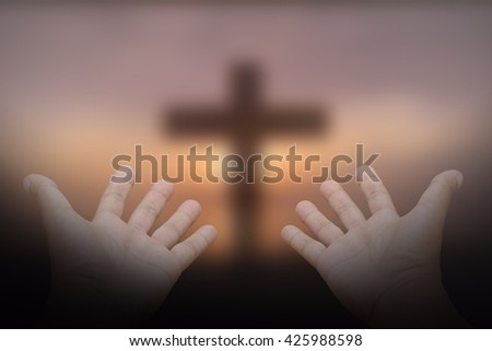 Hands, bless the cross in the sky. - stock photo