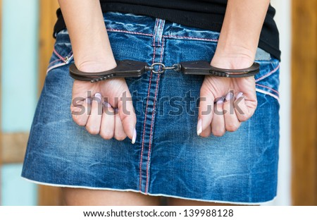 Hands bounded with handcuffs - stock photo