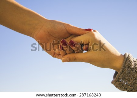 Hands clasped - stock photo