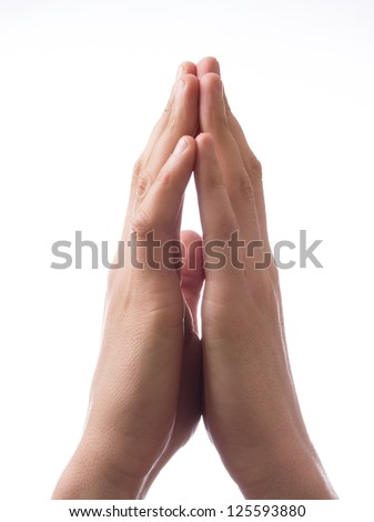 Hands clasped together for a prayer - stock photo