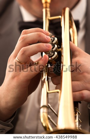 Hands closeup of a musician playing a trumpet