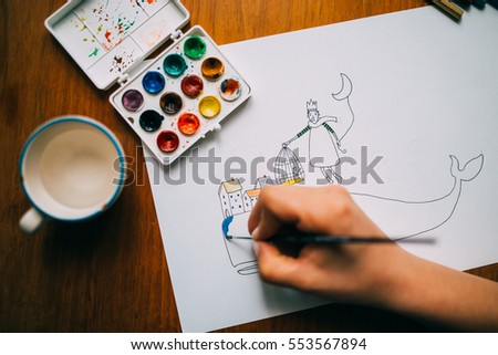 Hands coloring a beautiful drawing