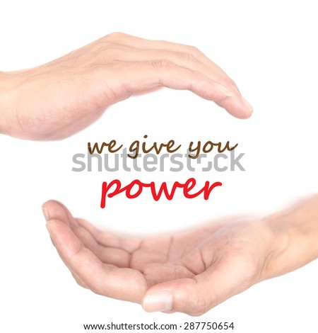 Hands concept for 'we give you power'. Quote is between right and left hand - stock photo