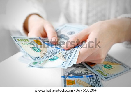 Hands counting money, close up - stock photo
