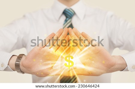 Hands creating a form with shining dollar sign in the center  - stock photo