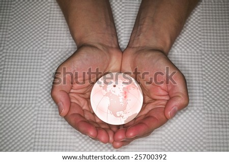 Hands cupped holding a glass globe